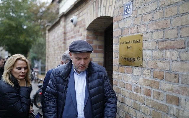 The leader of the Jewish community Max Privorozki (R) is pictured on October 10, 2019 in Halle, Germany, a day after the Yom Kippur attack outside a synagogue there in which two people were shot dead. (AXEL SCHMIDT / AFP)