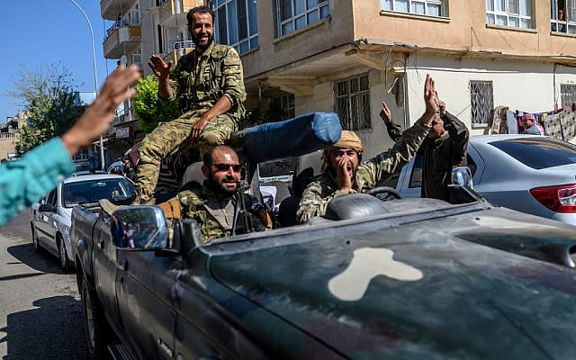 Turkey-backed Syrian opposition fighters going to Tel Abyad from Turkish gate towards Syria in Akcakale in Sanliurfa province on October 10, 2019. (BULENT KILIC/AFP)