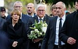 (L-R) German President's wife Elke Buedenbender and German President Frank-Walter Steinmeier arrive at the synagogue in Halle, eastern Germany, on October 10, 2019, one day after the attack where two people were shot dead (AXEL SCHMIDT / AFP)