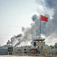 A picture taken in Akcakale at the Turkish border with Syria on October 10, 2019 shows smokes rising from the Syrian town of Tal Abyad after a mortar landed in the garden of a Turkish government building in Akcakale. (BULENT KILIC / AFP)