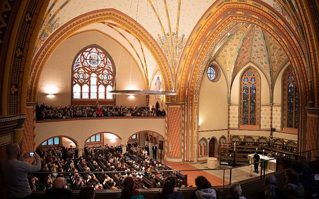 Mourners attend a vigil on October 10, 2019, in commemoration of the Halle shooting victims at the Pauluskirche church in Halle, eastern Germany, one day after the deadly anti-Semitic shooting. (Soeren Stache/DPA/AFP)