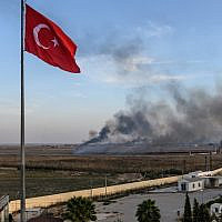 Smoke rises from the Syrian town of Tal Abyad, in a picture taken from the Turkish side of the border in Akcakale on October 10, 2019, on the second day of Turkey's military operation against Kurdish forces. (Bulent Kilic/AFP)