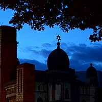 A Star of David on the cupola of the Halle synagogue silhouettes against the evening sky on October 10, 2019, in Halle, eastern Germany, one day after the deadly anti-Semitic shooting. (Soeren Stache/DPA/AFP)
