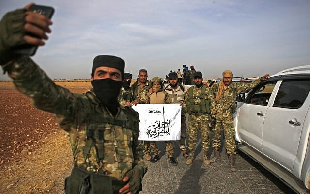 Pro-Turkish Syrian fighters gather near the Turkish village of Akinci along the border with Syria on October 11, 2019. (Bakr ALKASEM / AFP)