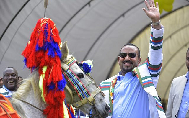 In this file photo taken on September 15, 2019, Ethiopian Prime Minister Abiy Ahmed gestures after receiving a horse as a gift from the elders of the Kafficho ethnic group during a visit to Bonga, the main town in Kaffa province, in southwestern Ethiopia. (Michael Tewlede/AFP)