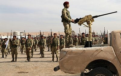 Turkish-backed Syrian rebels gather in al-Bab city in the eastern countryside of Aleppo province on October 11, 2019 as they prepare to take part in Turkey's invasion of northeastern Syria. - Turkish and allied forces faced stiff Kurdish resistance as they battled to seize key border towns, on the third day of a broad offensive that sparked a civilian exodus. (Photo by Zein Al RIFAI / AFP)