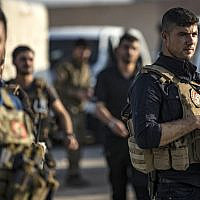 Members of the special forces of the Kurdish-led Syrian Democratic Forces (SDF) are pictured during preparations to join the front against Turkish forces, on October 10, 2019, near the northern Syrian town of Hasakeh.  (Delil SOULEIMAN / AFP)