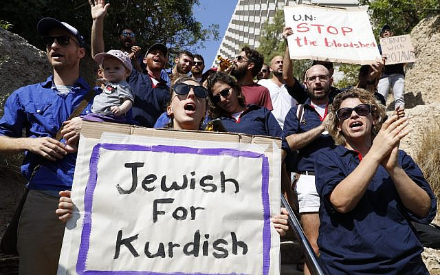 Israeli protesters hold placards during a demonstration against the Turkish military offensive in northeastern Syria, on October 13, 2019 in front of the Turkish embassy in Tel Aviv. (JACK GUEZ / AFP)