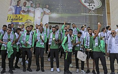 Members of Saudi Arabia's national soccer team are welcomed in the West Bank city of Ramallah on October 13, 2019, where they will play for the first time their match in the Asian qualifiers for the 2022 World Cup against Palestine in two days. (Abbas Momani/AFP)