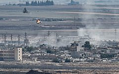 This picture taken on October 13, 2019 from the Turkish city of Ceylanpinar shows smoke rising and explosions in the Syrian border town of Ras al-Ayn as fighting rages along the border on the fifth day of a Turkish offensive in Syria (Ozan KOSE / AFP)