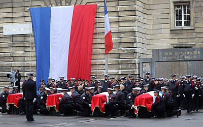 In this photo from October 8, 2019, police officers hold the coffins of their fallen colleagues during a ceremony at police headquarters in Paris, held to pay respects to the victims of a deadly stabbing attack at the prefecture on October 4, 2019. (Ludovic Marin/AFP)