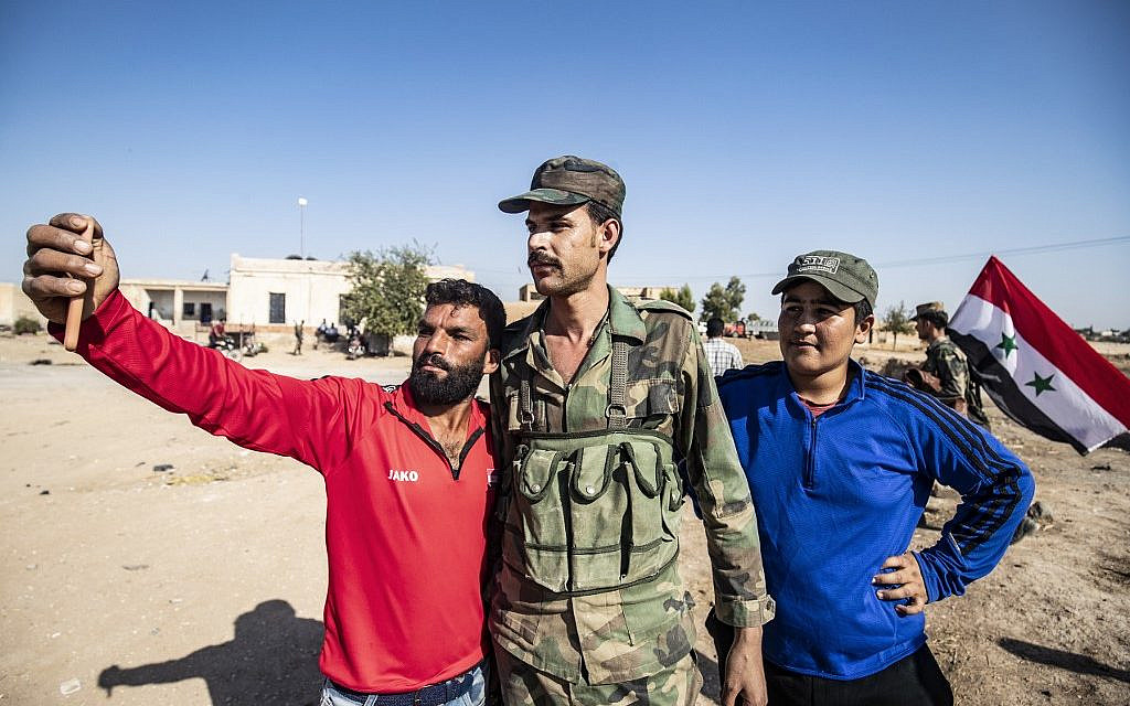 Syrian army moves to confront Turkish forces as US withdraws