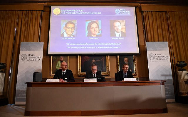 Chairman of the Nobel Committee for Economic Sciences, Peter Fredriksson, Secretary General of The Royal Swedish Academy of Sciences, Goeran K Hansson and member of the Nobel Committee for Economic Sciences Jakob Svensson are pictured during the announcement of the winners of the 2019 Nobel Prize in Economic Sciences at the Royal Swedish Academy of Sciences on October 14, 2019 in Stockholm. (Jonathan Nackstrand/AFP)
