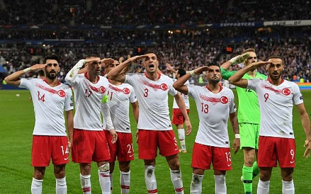 Turkish players salute at the end of the Euro 2020 Group H qualification football match between France and Turkey at the Stade de France in Saint-Denis, outside Paris on October 14, 2019. (Alain JOCARD / AFP)