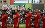 The Palestinian national football team stand for its national anthem during a World Cup 2022 Asian qualifying match between Palestine and Saudi Arabia in the West Bank town of al-Ram on October 15, 2019. (Ahmad GHARABLI / AFP)
