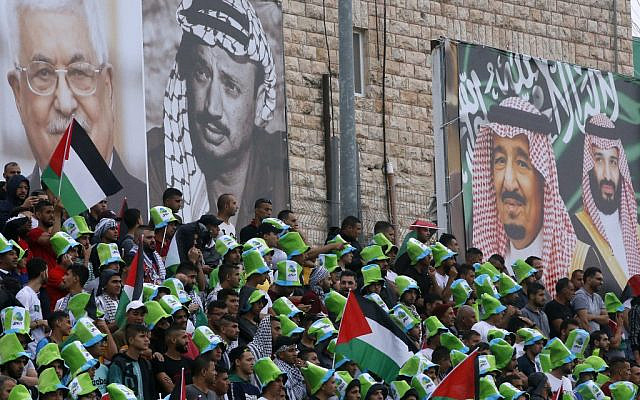 Saudi national football team players listen to their national anthem during a World Cup 2022 Asian qualifying match between Palestine and Saudi Arabia in the West Bank town of al-Ram on October 15, 2019. (HAZEM BADER/AFP)