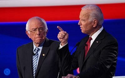 Democratic presidential hopefuls Vermont Senator Bernie Sanders (L) and former US Vice President Joe Biden during the fourth Democratic primary debate of the 2020 presidential campaign season co-hosted by The New York Times and CNN at Otterbein University in Westerville, Ohio on October 15, 2019. (SAUL LOEB/AFP)