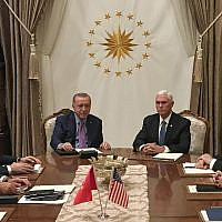 Turkish President Recep Tayyip Erdogan (C-L) and US Vice President Mike Pence (C-R), joined by Secretary of State Mike Pompeo (4R), Turkish Vice President Fuat Oktay (4L), Turkish Foreign Minister Mevlut Cavusoglu (3L) and senior aides, meet at the presidential complex in Ankara, Turkey, on October 17, 2019. (Shaun TANDON / POOL / AFP)
