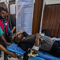 A man who was injured during the ongoing Turkish offensive against Kurdish-controlled areas of northeastern Syria lies at a hospital in Tal Tamr, near the Syrian Kurdish town of Ras al-Ain, October 18, 2019. (Delil Souleiman/AFP)