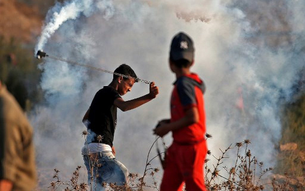 Palestinians riot on Gaza border; 48 said wounded