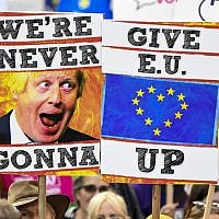 Illustrative: Demonstrators hold placards and EU and Union flags as they take part in a march by the People's Vote organisation in central London on October 19, 2019, calling for a final say in a second referendum on Brexit  (Niklas HALLE'N / AFP)