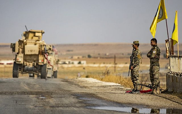 US military vehicles drive on a road in the town of Tal Tamr on October 20, 2019, after pulling out of their base (Delil SOULEIMAN / AFP)