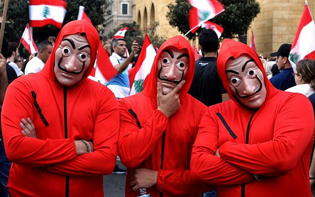 """Lebanese men wearing outfits from the Netflix series """"La Casa de Papelas"""" take part in a rally in downtown Beirut on the fourth day of demonstrations against tax increases and official corruption, October 20, 2019. (Patrick Baz/AFP)"""