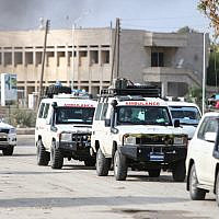 A convoy of ambulances evacuating fighters and injured members of the Kurdish-led Syrian Democratic Forces (SDF), as a well as wounded civilians, leaves the northeastern Syrian border town of Ras al-Ain on October 20, 2019. (Nazeer Al-Khatib/AFP)