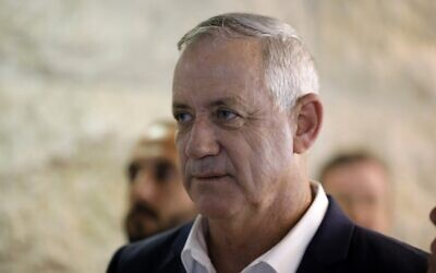 Retired General Benny Gantz, leader of the Blue and White political alliance, is pictured after paying his respects in front of the coffin of the recently deceased former Supreme Court president Meir Shamgar, in Jerusalem on October 22, 2019. (Menahem KAHANA / AFP)