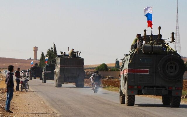 A convoy of Russian military vehicles drives toward the northeastern Syrian city of Kobane on October 23, 2019 (AFP)