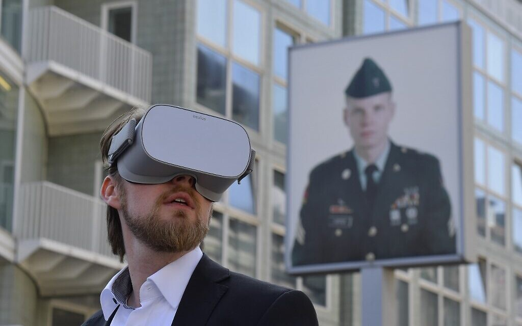 In this photo taken on August 22, 2019 Jonas Rothe, founder and CEO of Timeride, a company offering Virtual Reality tours through a still-divided Berlin, poses next to Checkpoint Charlie on August 22, 2019 in Berlin. (Tobias SCHWARZ / AFP)