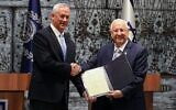 President Reuven Rivlin presents Blue and White party leader Benny Gantz with the mandate to form a new Israeli government, after PM Netanyahu's failure to form one, at the President's Residence in Jerusalem on October 23, 2019. (GALI TIBBON / AFP)