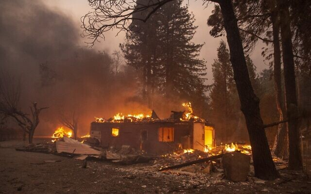 A home burns during the Kincade fire near Geyserville, California on October 24, 2019. (Josh Edelson / AFP)