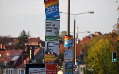 Different election campaign posters are fixed in a street in Erfurt, eastern Germany, on October 24, 2019. (Christof STACHE / AFP)