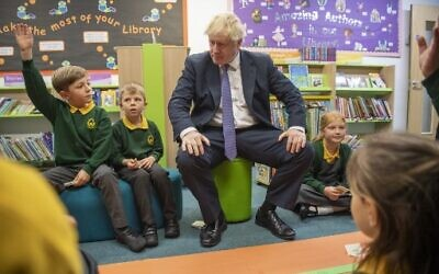Britain's Prime Minister Boris Johnson speaks to pupils as he visits Middleton Primary School in Milton Keynes, southern England on October 25, 2019. (Paul Grover/Pool/AFP)