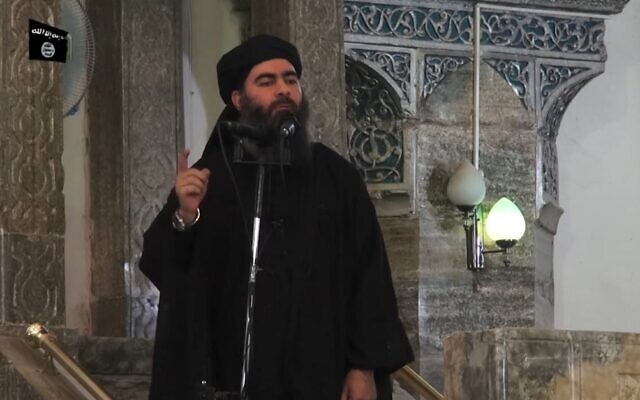 This file image grab taken on July 5, 2014 from a propaganda video released by al-Furqan Media allegedly shows the leader of the Islamic State jihadist group, Abu Bakr al-Baghdadi, addressing Muslim worshipers at a mosque in the northern Iraqi city of Mosul, held at the time by IS. (AFP)