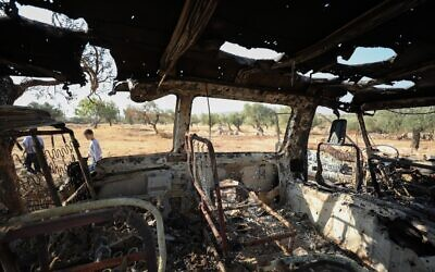A picture taken on October 27, 2019 shows a burnt vehicle near the site where helicopter gunfire reportedly killed nine people near the northwestern Syrian village of Barisha in the province of Idlib near the border with Turkey, where 'groups linked to the Islamic State group' were present, according to a Britain-based war monitor with sources inside Syria (Omar HAJ KADOUR / AFP)