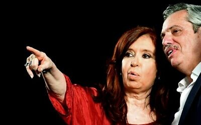 Argentina's former president and new vice president Cristina Fernandez waves at supporters next to president elect Alberto Fernandez, at the headquarters of the party in Buenos Aires on October 27, 2019. - Peronist candidate Alberto Fernandez won Argentina's presidential election in the first round on Sunday, official results showed, bringing to an end the crisis-plagued rule of market-friendly incumbent Mauricio Macri. (Photo by RONALDO SCHEMIDT / AFP)