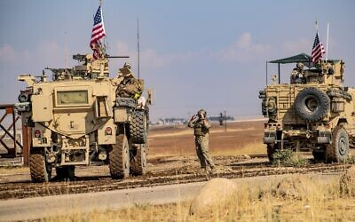 A convoy of US military vehicles drives through the Syrian northeastern town of Qahtaniyah on the border with Turkey on October 31, 2019  (Delil SOULEIMAN / AFP)