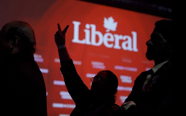 Liberal supporters react as they watch results roll in at Canadian Prime Minister Justin Trudeau's election night headquarters on October 21, 2019, in Montreal, Canada. (Cole Burston/Getty Images/AFP)