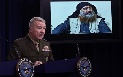 "US Marine Corps General Kenneth ""Frank"" McKenzie, commander of US Central Command, speaks as a picture of Abu Bakr al-Baghdadi is seen during a press briefing October 30, 2019 at the Pentagon in Arlington, Virginia. (Alex Wong/Getty Images/AFP)"