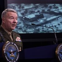 "Marine Corps Gen. Kenneth ""Frank"" McKenzie, commander of U.S. Central Command, speaks as a picture of the operation targeting Abu Bakr al-Baghdadi is seen during a press briefing October 30, 2019 at the Pentagon in Arlington, Virginia. (Alex Wong/Getty Images/AFP)"