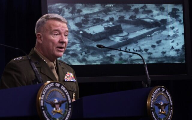 "Gen. Kenneth ""Frank"" McKenzie, commander of US Central Command, speaks next to a picture of the operation targeting Abu Bakr al-Baghdadi during a press briefing October 30, 2019 at the Pentagon in Arlington, Virginia. (Alex Wong/Getty Images/AFP)"