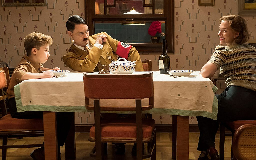 Scarlet Johansson, right, plays Jojo's mother, who takes in a Jewish girl to hide her from the Nazis. (Kimberley French/Twentieth Century Fox Film Corp. via JTA)