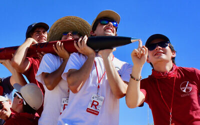 Daniel Shorr, far right, and other members of Stanford's Student Space Initiative escort a rocket he built. (Courtesy of Shorr/via JTA)
