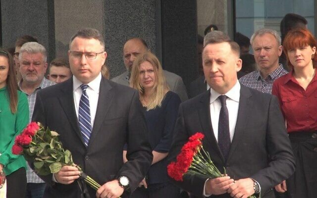 Alexander Vindman, left, the National Security Council Director for European Affairs, lays flowers to honor fallen Ukrainian soldiers in Kiev on May 21, 2019. (US Embassy in Kiev/Twitter)