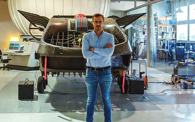 Host and executive producer Jonny Caplan stands in front of an Urban Aeronautics flying car during filming for Season One of 'TechTalk,' to be released on Amazon Prime on October 18, 2019. (Courtesy)