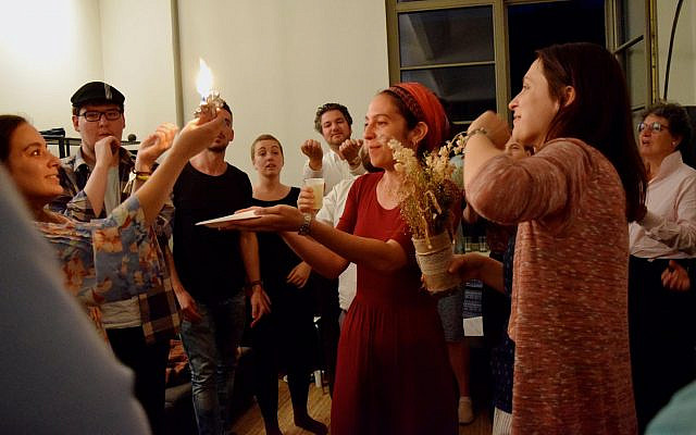 Rabbi Rebecca Blady, center, performs the havdallah ceremony in 2017. (Courtesy Base BERLIN)