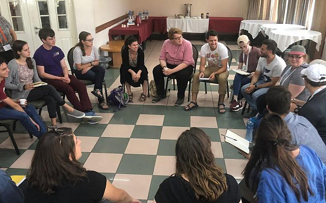 College students on J Street's summer trip to Israel and the West Bank participate in a group discussion, July 2019 (Courtesy)