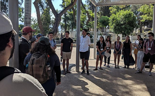 Students gather for a debriefing session on J Street's 'Let Our People Know' trip to Israel and the West Bank in July 2019 (Courtesy)